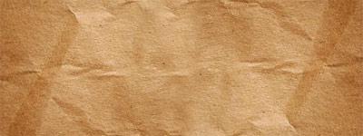 Скачать A plain brown paper bag texture.